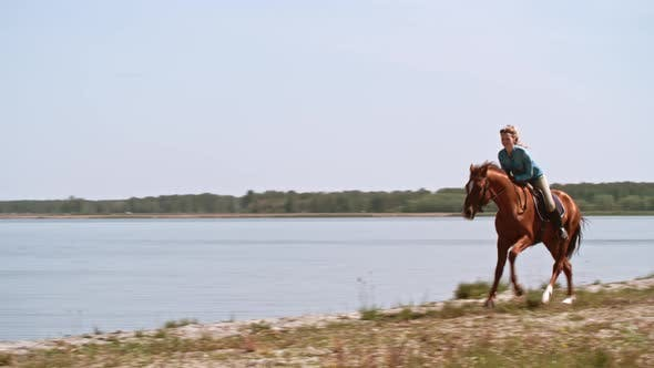 Thumbnail for Smiling Female Rider Galloping Horse