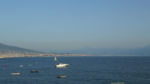 Boats floating in Bay of Naples, beautiful landscape of Mount Vesuvius, Italy