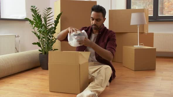 Thumbnail for Indian Man Packing Boxes and Moving To New Home 1