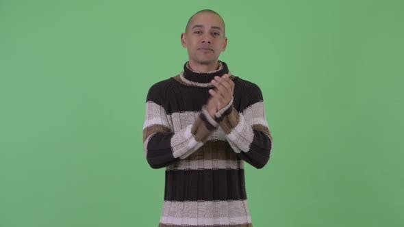 Thumbnail for Happy Bald Multi Ethnic Man Clapping Hands Ready for Winter