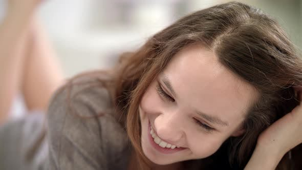 Thumbnail for Happy Woman Face. Smiling Woman Touching Hair. Portrait of Cheerful Girl