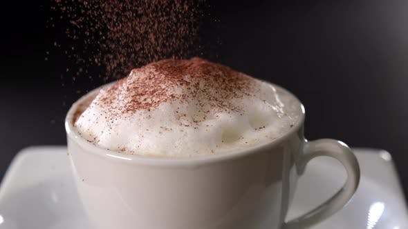 Thumbnail for Pouring Cocoa on Cappuccino