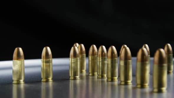 Cinematic rotating shot of bullets on a metallic surface - BULLETS 034