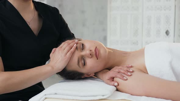 Thumbnail for Cute Handsome Woman During Massage on the Face in the Massage Salon