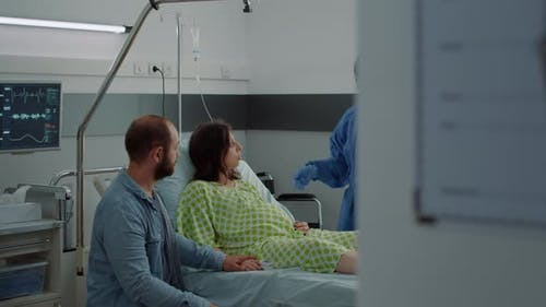 Caucasian Couple Expecting Baby in Maternity Ward