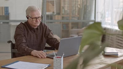 Senior Businessman Video Conferencing in Office