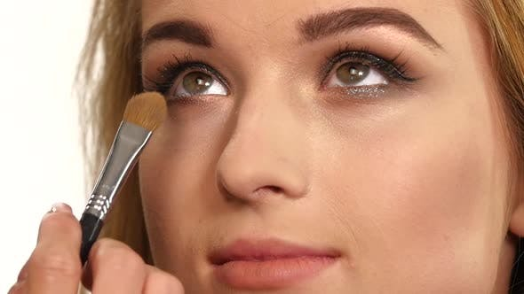 Thumbnail for Beauty Girl with Makeup Brush, Close Up, Slow Motion