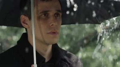 Man Under Umbrella at the Funeral
