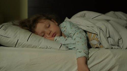 Cute Little Kid Girl Sleeping Well Alone in Bed