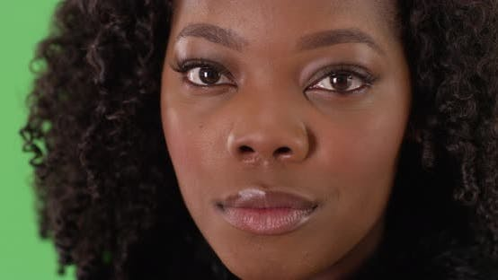 Thumbnail for Close up of lovely black female with gentle smile on green screen to be keyed