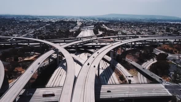 Thumbnail for Static Drone Aerial Shot of Large Complex Highway Road Junction with Cars Moving Through Multiple