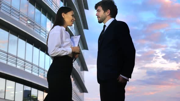 Thumbnail for Businessman and Businesswoman Meet in the Street and Go To Work Together
