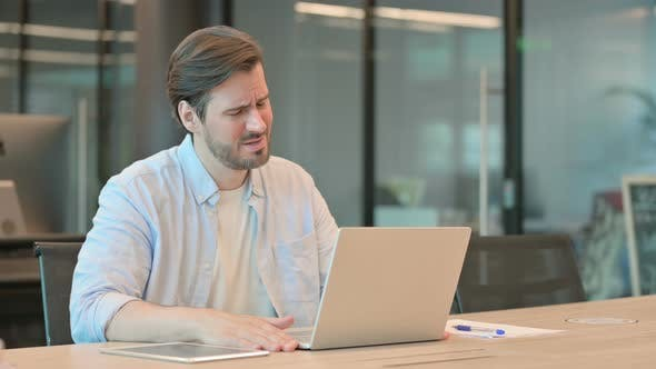 Man with Laptop Having Loss Failure