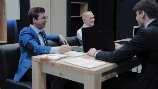 Businessmen Talk and Smile