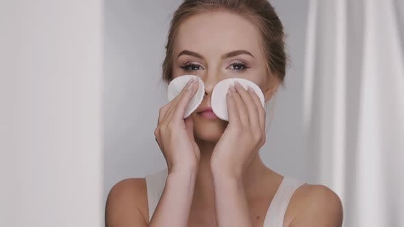 Thumbnail for Girl Removing Make-up with Two White Cotton Pads