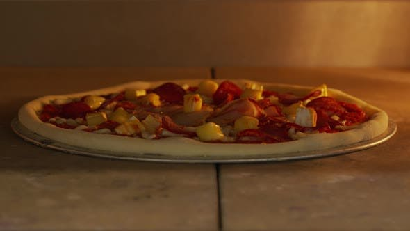 Timelapse of a Pizza Being Cooked in the Oven. Close-up Melting Cheese.