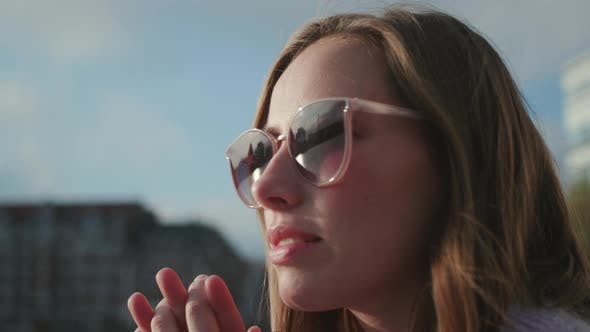 Thumbnail for Brunette In Sunglasses With Hands Clasped