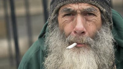 old homeless smoking: closeup portrait of a real homeless