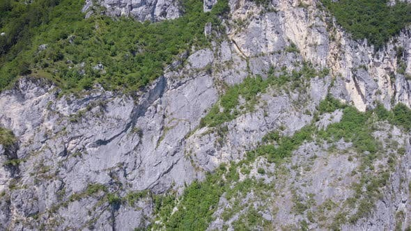 Thumbnail for Aerial View. The Frame Is a Huge Sheer Cliff. Beautiful Mountain Landscape with Stone and Vegetation