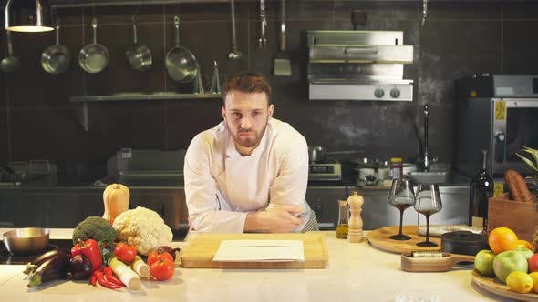 Portrait of Young Chef Looking Straight To the Camera in Kitchen