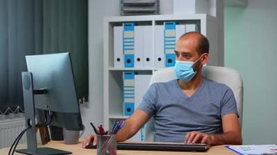 Manager with Face Mask Working in Office