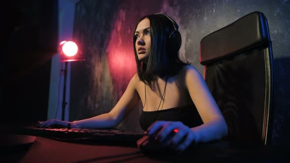 Woman Starts Online Game with Her Friends. Gamer Girl Playing Online Game on a Pc Computer