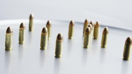 Cinematic rotating shot of bullets on a metallic surface - BULLETS 058