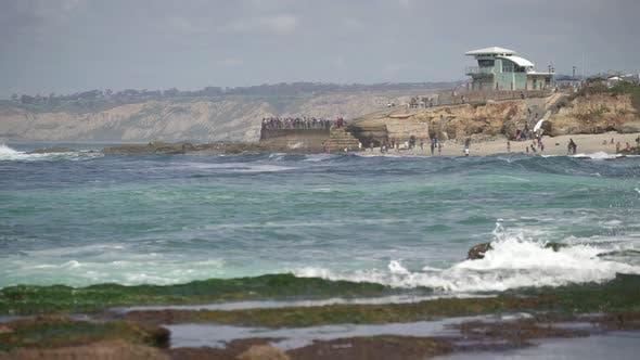 Thumbnail for Waves crashing into rocks