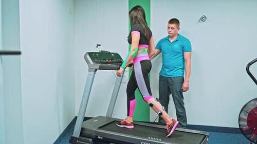 Young Woman Doing Exercises Under Physiotherapist Supervision