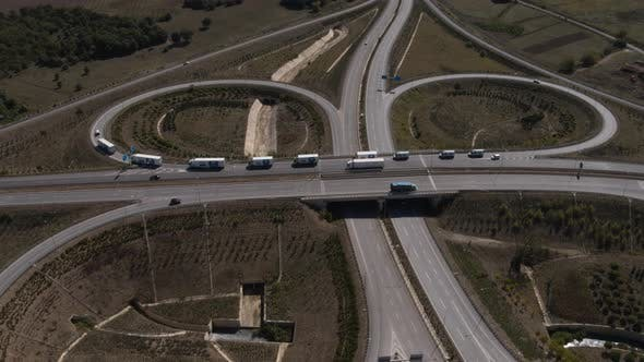 Thumbnail for Highway Intersection Roundabout Trucks Passing Aerial View