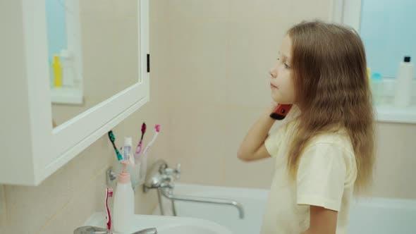 Happy Portrait Cute Caucasian Young Girl In Bathroom.