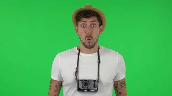 Thumbnail for Portrait of Tourist on Vacation Is Saying Wow with Shocked Facial Expression Takes Pictures on Retro