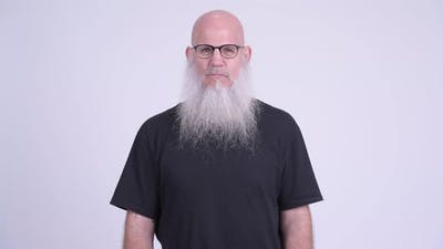 Mature Bald Bearded Man with Finger on Lips
