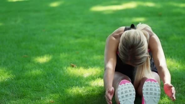 Thumbnail for Athlete Woman Doing Stretch Exercise Before Fitness Training in Summer Park