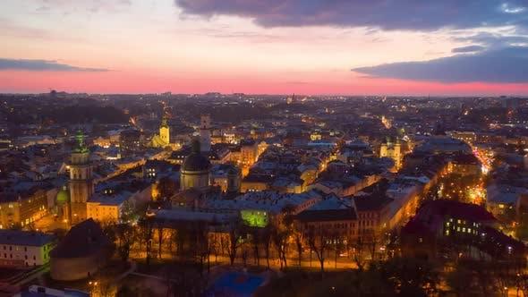 Thumbnail for Aerial Hyperlapse Time Lapse, Flight Above the Roofs on Sunset, Old European City, Ukraine Lviv