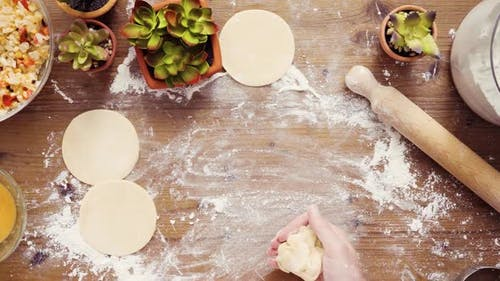 Flat lay. Step by step. Rolling dough for home made empanadas.