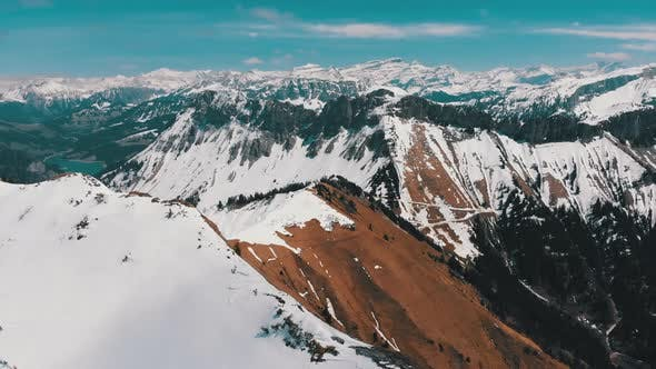 Aerial Drone View on Snowy Peaks of Swiss Alps. Switzerland. Rochers-de-Naye Mountain Peak