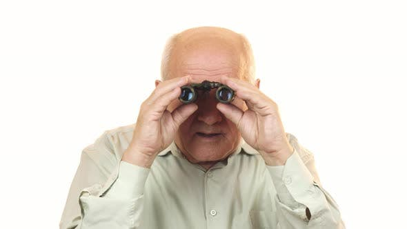 Cover Image for Old Man Using Binoculars Looking Surprised To the Camera