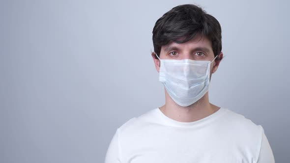 Thumbnail for Man in a Medical Mask, Isolated on a Gray Background