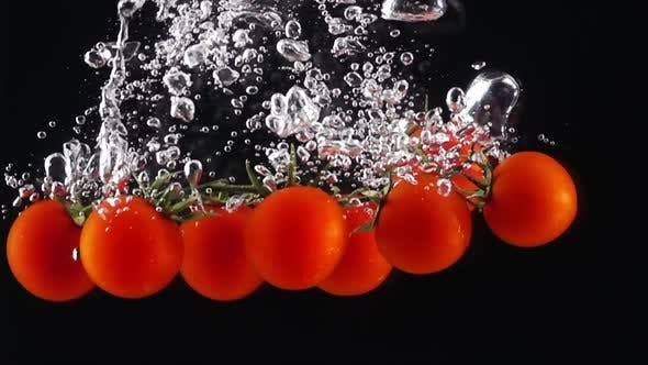 Thumbnail for Whole Tomatoes Falling Through Water