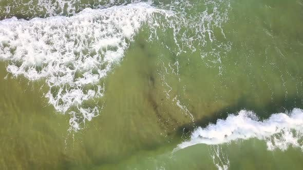 Thumbnail for Top View of the Foaming Turquoise Waves. Aerial Survey