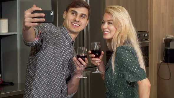 Thumbnail for Young Happy Couple Taking Selfies with Smart Phone, Celebrating Valentines Day