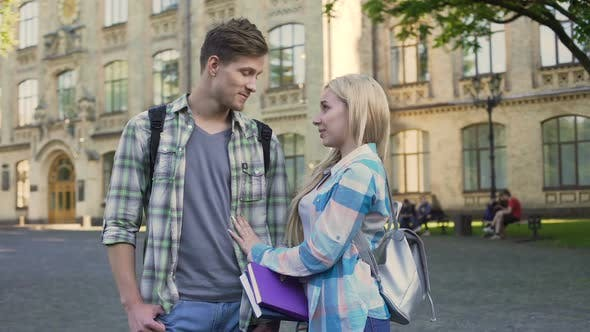 Thumbnail for Cheerful Couple of Students Joking and Talking Near University, Relationship
