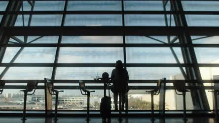 Thumbnail for Woman silhouette sitting in front of big terminal window. BMPCC 4K