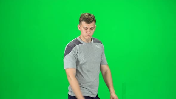 Thumbnail for Guy Goes and Dances, Smiles and Rejoices on a Green Screen, Chroma Key. Side View