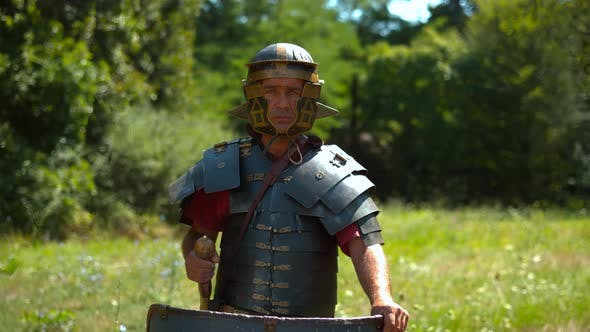 Fearless Roman soldier with armor, ultra slow motion