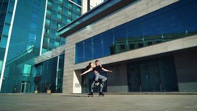 Roller skaters performing stunts in city