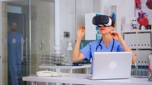 Medical Nurse Experiencing Virtual Reality Using Vr Goggles in Hospital