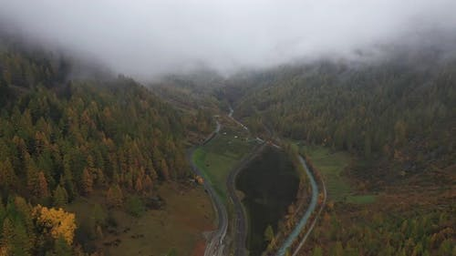 Aerial view of a waving road in countryside, Ardon, Switzerland.
