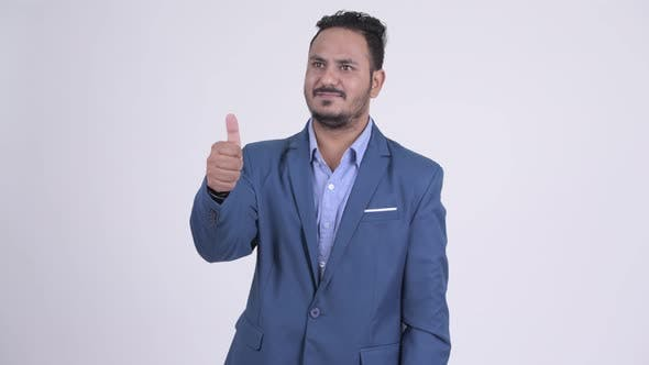 Thumbnail for Happy Bearded Indian Businessman Giving Thumbs Up